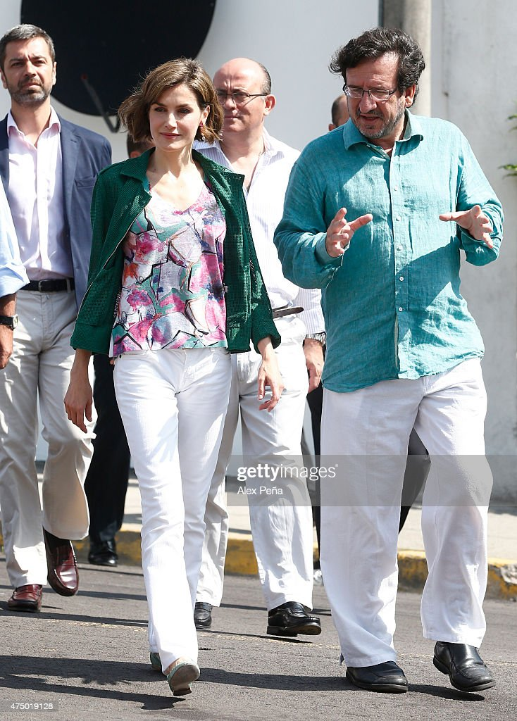 Queen Letizia of Spain walks accompanied by Fernando Fajardo director of the Cultural Center of Spain in El Salvador during an official visit to El Salvador on May 28, 2015 in San Salvador, El Salvador.
