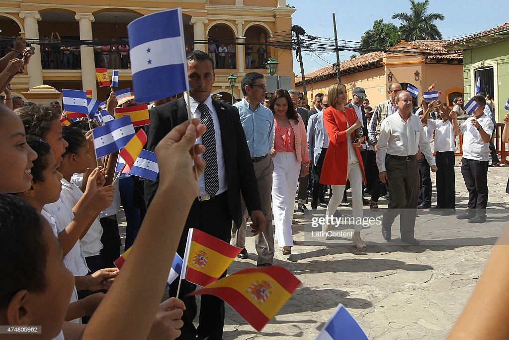 Queen Letizia walks with Honduran authorities on a street of Comayagua, 80 km north of Tegucigalpa during an official visit on May 26, 2015 in Honduras. Queen Letizia started a two-day visit to Honduras to supervise Spanish cooperation programs in the country.