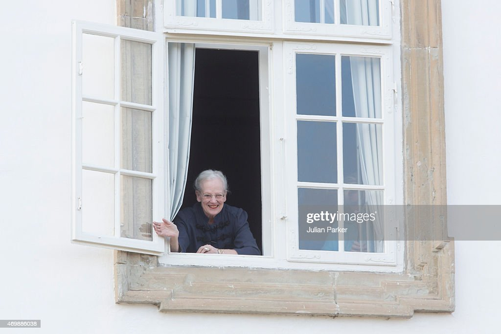 Queen Margarethe II of Denmark waves from the window of Fredensborg Palace during the traditional morning greeting, on her 75th Birthday, on April 16, 2015 in Fredensborg, Denmark.