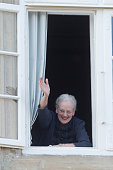 Queen Margarethe II of Denmark waves from the window of Fredensborg Palace during the traditional morning greeting on her 75th Birthday on April 16...