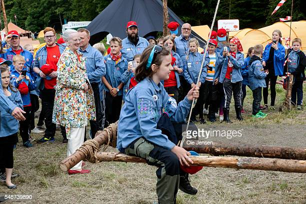 Queen Margrethe admires the scouts creativity here a carousel during her visit to FDF summer camp in Ry Denmark on July 7 2016 The Queen and her...