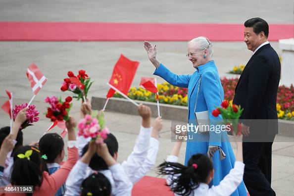 Queen Margrethe II of Denmark and Chinese President Xi Jinping attend a welcome ceremony outside the Great Hall of the People on April 24 2014 in...