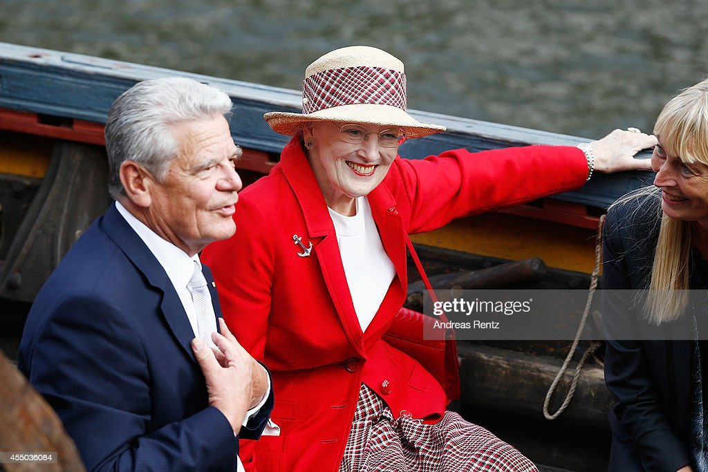 Queen Margrethe II of Denmark (R) and German President Joachim Gauck listen to a presentation aboard the remake of a Viking ship on September 9, 2014 in Berlin, Germany. Queen Margrethe is in Berlin on a two-day visit, during which she will open an exhibition about the Vikings at Martin-Gropius-Bau.