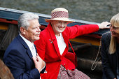 Queen Margrethe II of Denmark and German President Joachim Gauck listen to a presentation aboard the remake of a Viking ship on September 9 2014 in...