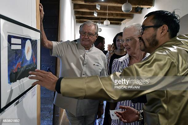 Queen Margrethe II of Denmark and her husband Prince Henrik listen to Greenlandic artist Nuka K Godtfredsen during a visit to an art exhibition by...