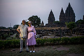 Queen Margrethe II of Denmark and her husband Prince Henrik pose for a photo during their visit at Prambanan temple on October 24 2015 in Yogyakarta...