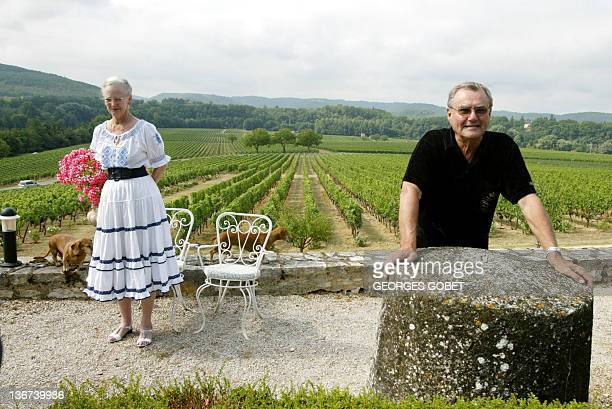 Queen Margrethe II of Denmark and her husband Prince Henrik pose in their garden before meeting journalists 11 August 2005 in the castle of Caix...