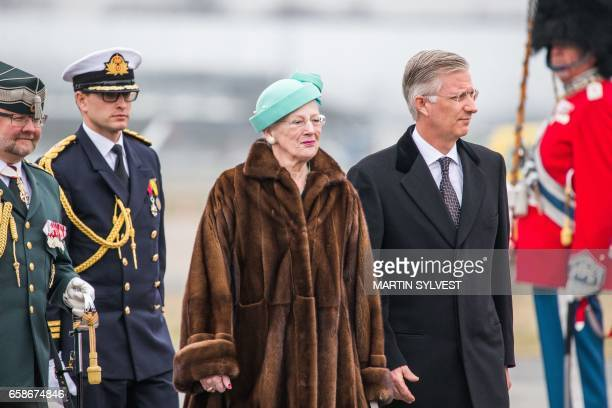 Queen Margrethe II of Denmark and King Philippe of Belgium inspect the Danish guard of honor during a welcoming ceremony at Copenhagen Airport on...