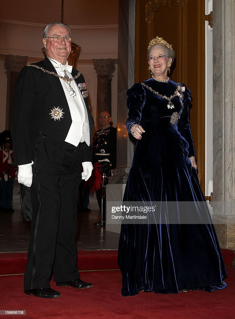 <a gi-track='captionPersonalityLinkClicked' href=/galleries/search?phrase=Queen+Margrethe+II+of+Denmark&family=editorial&specificpeople=171794 ng-click='$event.stopPropagation()'>Queen Margrethe II of Denmark</a> and Prince Consort Henrik of Denmark arrive at a New Year's Banquet hosted by Queen Margrethe of Denmark at Christian VII's Palace on January 1, 2013 in Copenhagen, Denmark.