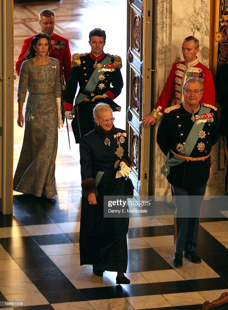 <a gi-track='captionPersonalityLinkClicked' href=/galleries/search?phrase=Queen+Margrethe+II+of+Denmark&family=editorial&specificpeople=171794 ng-click='$event.stopPropagation()'>Queen Margrethe II of Denmark</a> and Prince Consort Henrik of Denmark, Crown Prince Frederik, and <a gi-track='captionPersonalityLinkClicked' href=/galleries/search?phrase=Crown+Princess+Mary+of+Denmark&family=editorial&specificpeople=158374 ng-click='$event.stopPropagation()'>Crown Princess Mary of Denmark</a> attend New Year's Levee held by Queen Margrethe of Denmark at Christian VII's Palace on January 3, 2013 in Copenhagen, Denmark.