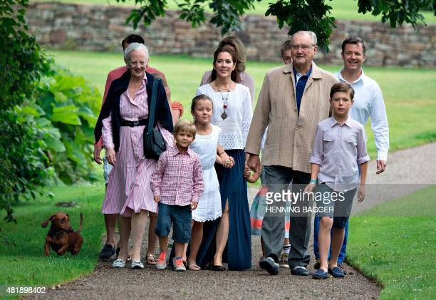 Queen Margrethe II of Denmark and Prince Consort Henrik walk with members of the Danish royal family which holds summer holidays at Graasten Castle...
