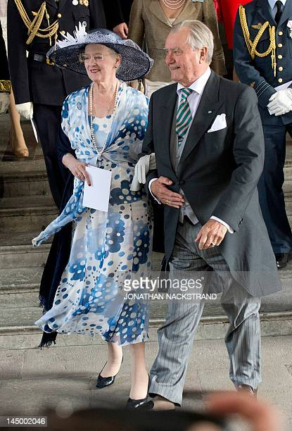 Queen Margrethe II of Denmark and Prince Henrik of Denmark leave the Royal Chapel on May 22 2012 after the christening of Princess Estelle of Sweden...