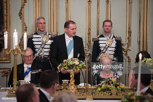 Queen Margrethe II of Denmark and Prince Henrik of Denmark listen to Icelandic President Gudni Johannesson giving a speech during a Gala Dinner for...