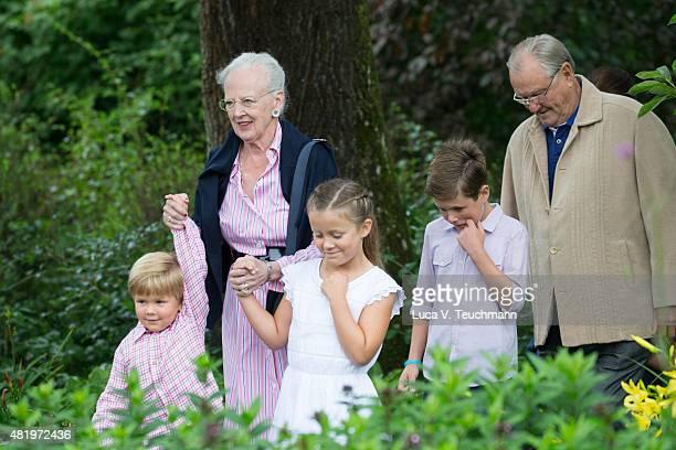 Queen Margrethe II of Denmark and Prince Henrik of Denmark walk their grandchildren Prince Vincent of Denmark Princess Isabella of Denmark and Prince...