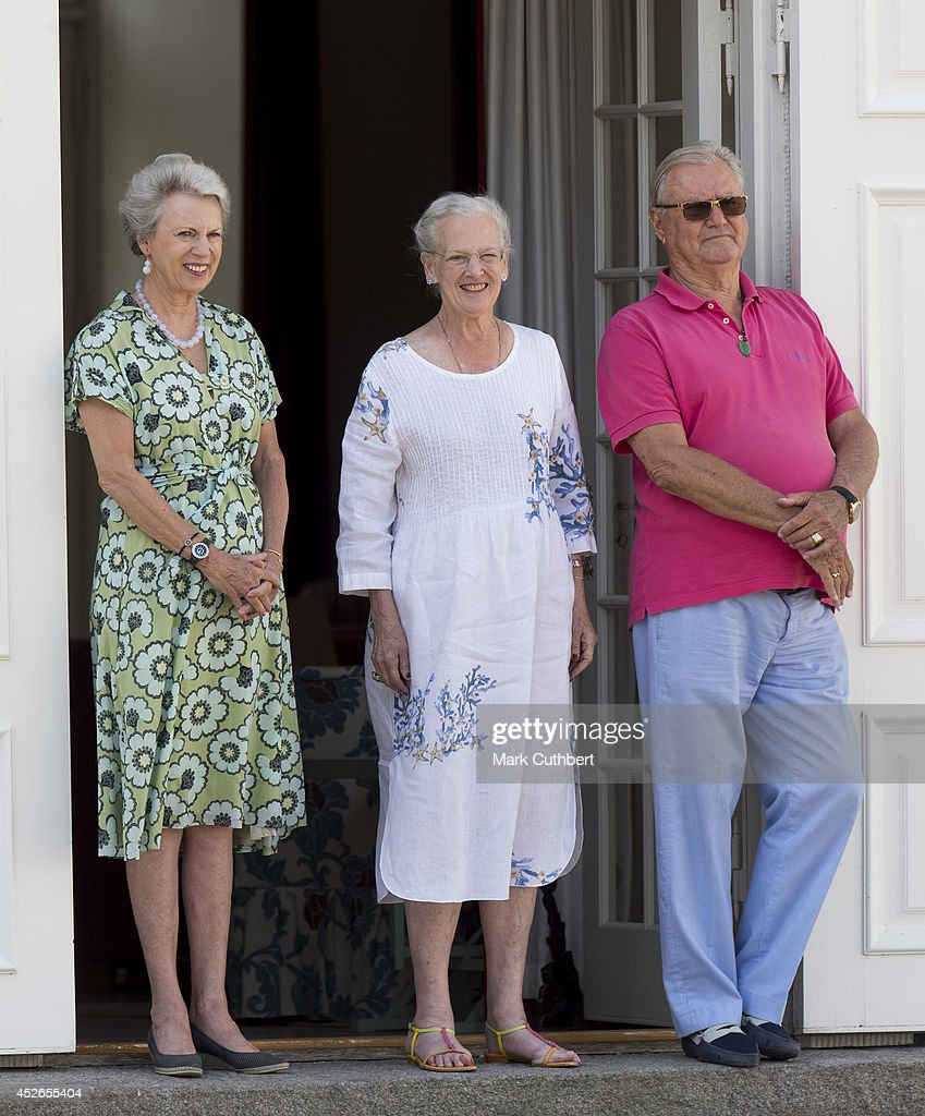 Queen Margrethe II of Denmark and Prince Henrik of Denmark with Princess Benedikte of Denmark watch the changing of the guard at Grasten Castle on...