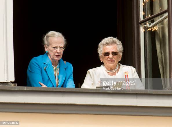Queen Margrethe II of Denmark and Princess Astrid of Norway watch the National Day Childrens Parade from the Royal Palace on May 17 2014 in Oslo...