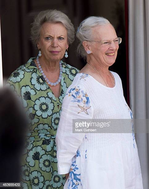 Queen Margrethe II of Denmark and Princess Benedikte of Denmark watch the changing of the guard at Grasten Castle on July 25 2014 in Grasten Denmark
