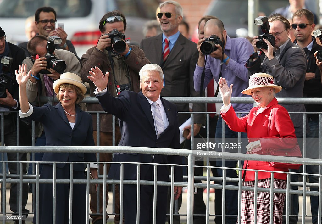 Queen Margrethe II of Denmark (R), German President Joachim Gauck (C) and German First Lady Daniela Schadt wave to onlookers upon their arrival to board the remake of a Viking ship on September 9, 2014 in Berlin, Germany. Queen Margrethe is in Berlin on a two-day visit, during which she will open an exhibition about the Vikings at Martin-Gropius-Bau.