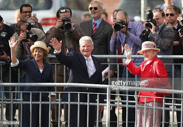 Queen Margrethe II of Denmark German President Joachim Gauck and German First Lady Daniela Schadt wave to onlookers upon their arrival to board the...