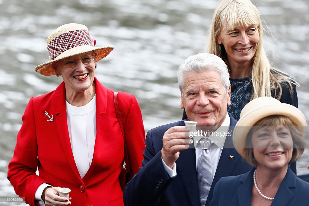Queen Margrethe II of Denmark (L), German President Joachim Gauck (C) and German First Lady Daniela Schadt have a shot upon their arrival to board the remake of a Viking ship on September 9, 2014 in Berlin, Germany. Queen Margrethe is in Berlin on a two-day visit, during which she will open an exhibition about the Vikings at Martin-Gropius-Bau.