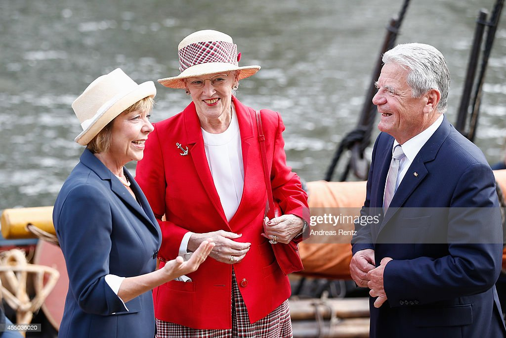 Queen Margrethe II of Denmark (C) German President Joachim Gauck (R) and German First Lady Daniela Schadt smile upon their arrival to board the remake of a Viking ship on September 9, 2014 in Berlin, Germany. Queen Margrethe is in Berlin on a two-day visit, during which she will open an exhibition about the Vikings at Martin-Gropius-Bau