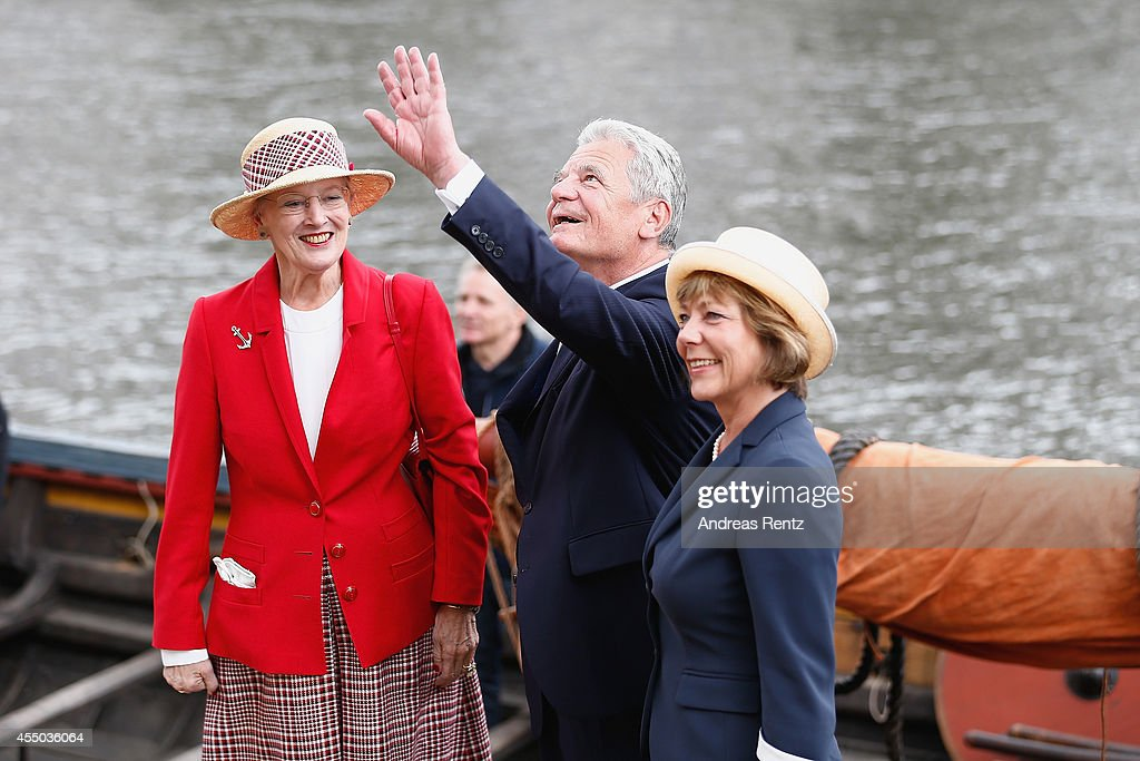 Queen Margrethe II of Denmark (L), German President Joachim Gauck (C) and German First Lady Daniela Schadt wave to onlookers upon their arrival to board the remake of a Viking ship on September 9, 2014 in Berlin, Germany. Queen Margrethe is in Berlin on a two-day visit, during which she will open an exhibition about the Vikings at Martin-Gropius-Bau.