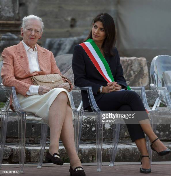 Queen Margrethe II of Denmark is flanked by Virginia Raggi Mayor of Rome as she visits the archaeological site of the Roman Forum during her threeday...