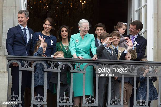 Queen Margrethe II of Denmark is joined by Frederik Crown Prince of Denmark Princess Isabella of Denmark Crown Princess Mary of Denmark Prince...