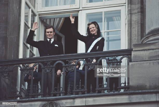 Queen Margrethe II of Denmark pictured with her husband Henrik Prince Consort of Denmark as they wave to crowds from a balcony at Christiansborg...