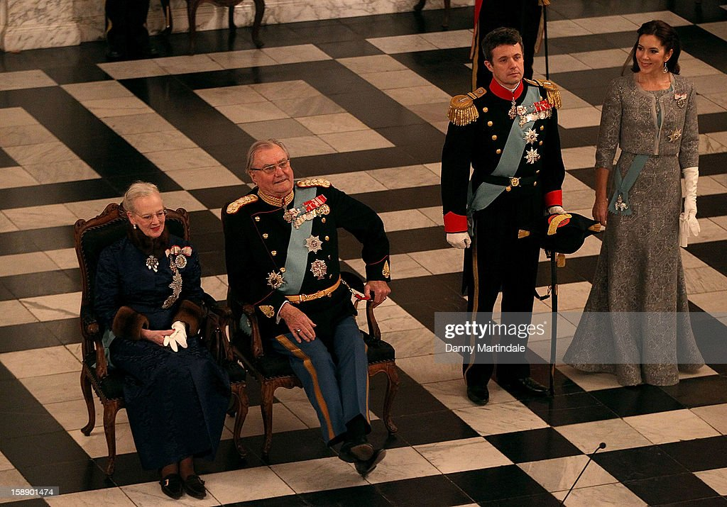 <a gi-track='captionPersonalityLinkClicked' href=/galleries/search?phrase=Queen+Margrethe+II+of+Denmark&family=editorial&specificpeople=171794 ng-click='$event.stopPropagation()'>Queen Margrethe II of Denmark</a>, Prince Consort Henrik of Denmark, Crown Prince Frederik, and <a gi-track='captionPersonalityLinkClicked' href=/galleries/search?phrase=Crown+Princess+Mary+of+Denmark&family=editorial&specificpeople=158374 ng-click='$event.stopPropagation()'>Crown Princess Mary of Denmark</a> attend New Year's Levee held by Queen Margrethe of Denmark at Christian VII's Palace on January 3, 2013 in Copenhagen, Denmark.