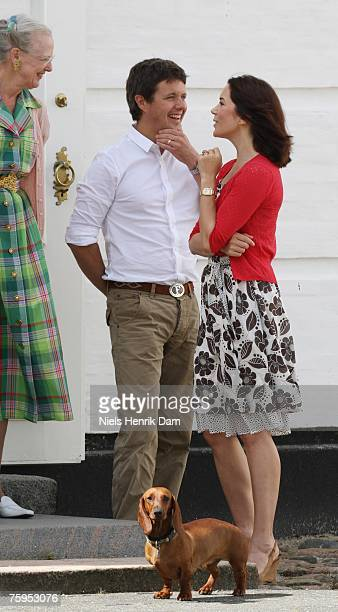 Queen Margrethe II of Denmark Prince Frederick of Denmark and Princess Mary of Denmark attend a photocall at their summer residence of Grasten Slot...