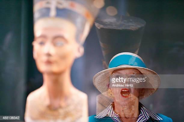Queen Margrethe II of Denmark regards intently the bust of 3400yearold Egyptian beauty Queen Nefertiti on September 10 2014 in Berlin Germany Queen...