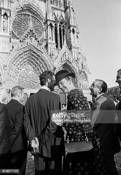 Queen Margrethe II of Denmark shares a laugh with her husband Prince Henrik During the royal couple's trip to France they visited Reims Cathedral and...
