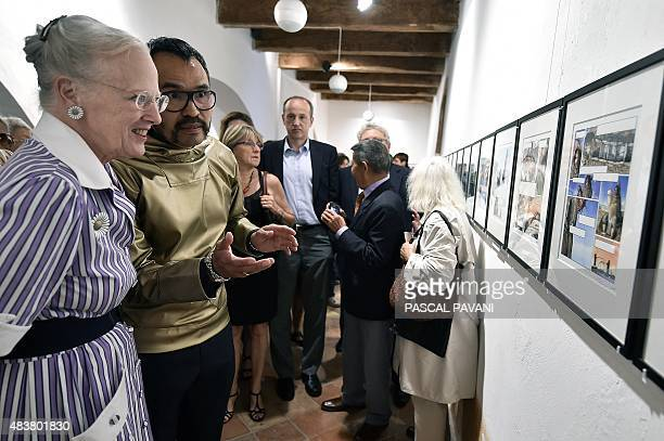 Queen Margrethe II of Denmark speaks with Greenlandic artist Nuka K Godtfredsen during a visit to an art exhibition by the Prince Consort entitled...