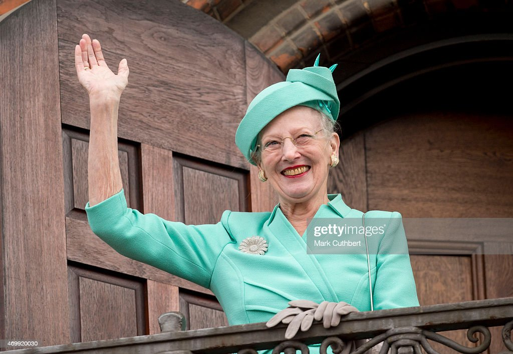 Queen Margrethe II of Denmark waves from the Town Hall balcony after lunch during festivities for her 75th birthday on April 16, 2015 in Copenhagen, Denmark.