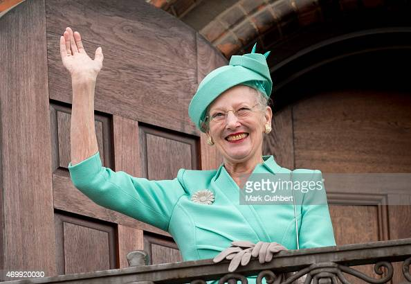 Queen Margrethe II of Denmark waves from the Town Hall balcony after lunch during festivities for her 75th birthday on April 16 2015 in Copenhagen...