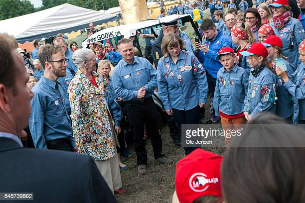 Queen Margrethe is surrounded by FDF scouts during her visit to FDF summer camp in Ry Denmark on July 7 2016 The Queen and her entourage which...