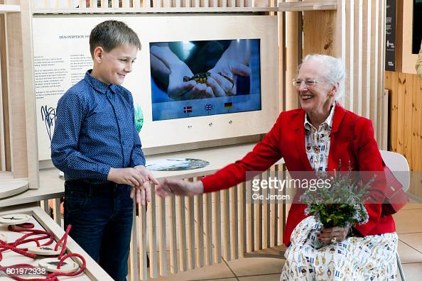 Queen Margrethe listen to Marcus who explains about the nature around the island of Strynoe which the Queen visited during her tour of Langeland in...