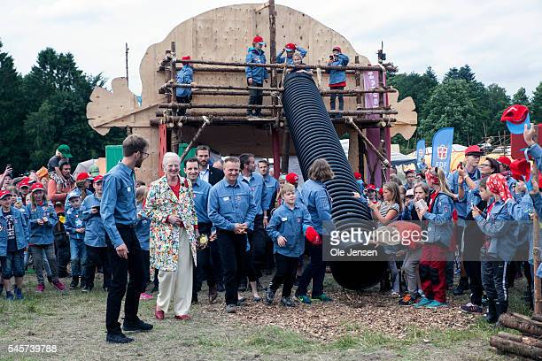 Queen Margrethe looks at some of the activities during her visit to FDF summer camp in Ry Denmark on July 7 2016 The Queen and her entourage which...