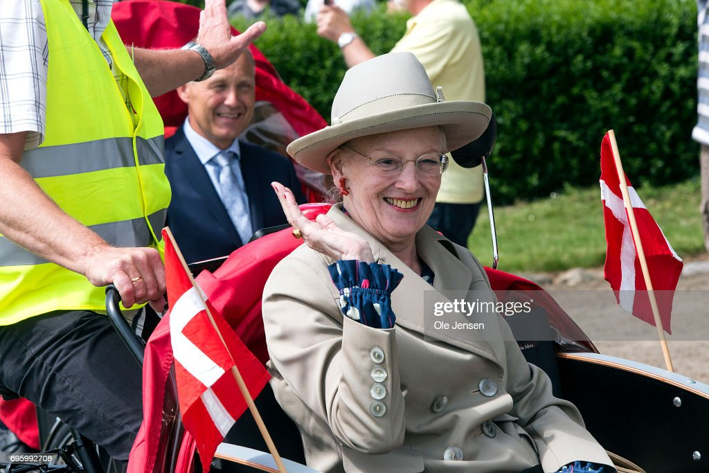 Queen Margrethe of Denmar is during her visit carried in a rickshaw at the waterfront on June 14, 2017 in Kalundborg, Denmark. Queen Margrethe is on a two days visit to Kalundborg. The Queen arrived to the Danish harbour city on board the Royalship Dannebrog and continue the trip to Mariaager for another two days visit wich begins June 15.