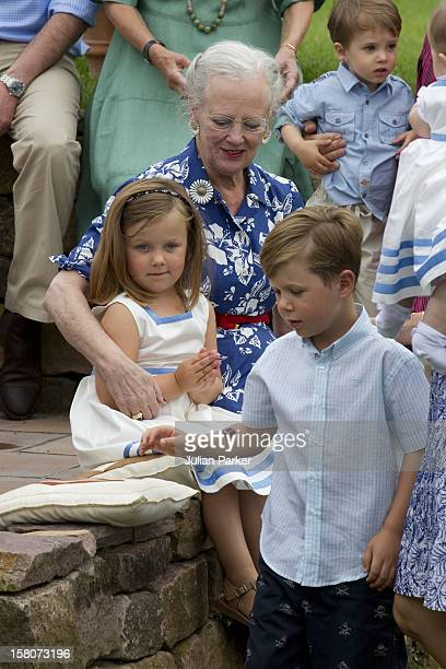 Queen Margrethe Of Denmark And Her Grandaughter Princess Isabella And Grandson Prince Christian Attend A Photocall For The Danish Royal Family At...