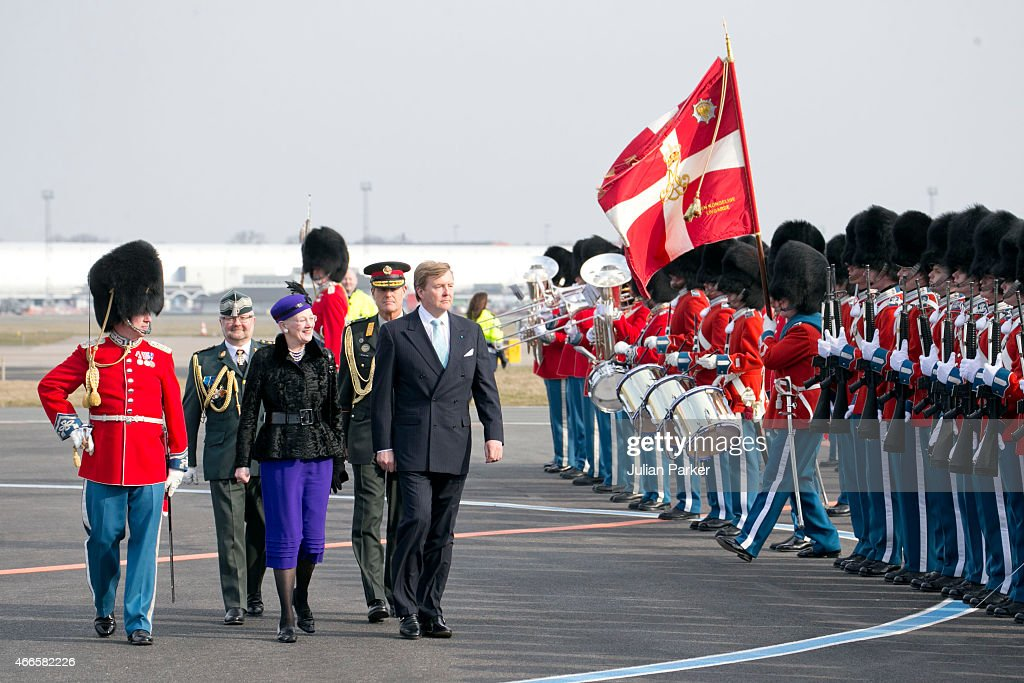 Queen Margrethe of Denmark, and King Willem Alexander of the Netherlands inspect The Guard of Honour on arrival at Copenhagen Airport at the start of a Dutch State visit to Denmark on March 17, 2015 in Copenhagen, Denmark.