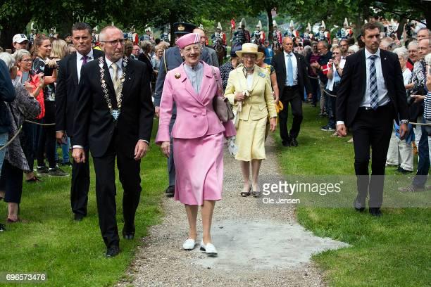 Queen Margrethe of Denmark flanked by mayor Mogens Jespersen arrive to an activity center for senior citizens during her visit on June 15 2017 in...