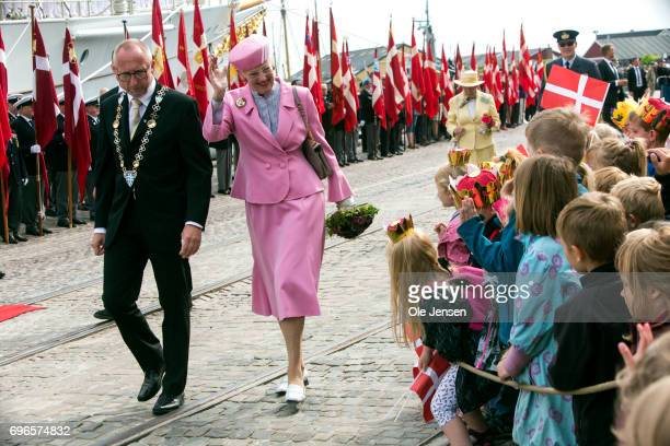 Queen Margrethe of Denmark followed by mayor Mogens Jespersen waves to the many hundred spectators during her arrival onboard the Royal ship...
