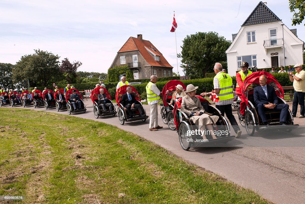 Queen Margrethe of Denmark (R - 2d) is during her visit carried in a rickshaw at the waterfront on June 14, 2017 in Kalundborg, Denmark. Queen Margrethe is on a two days visit to Kalundborg. The Queen arrived to the Danish harbour city on board the Royalship Dannebrog and continue the trip to Mariaager for another two days visit wich begins June 15.