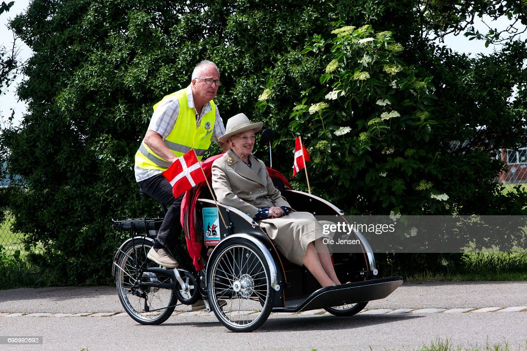 Queen Margrethe of Denmark is during her visit carried in a rickshaw at the waterfront on June 14, 2017 in Kalundborg, Denmark. Queen Margrethe is on a two days visit to Kalundborg. The Queen arrived to the Danish harbour city on board the Royalship Dannebrog and continue the trip to Mariaager for another two days visit wich begins June 15.