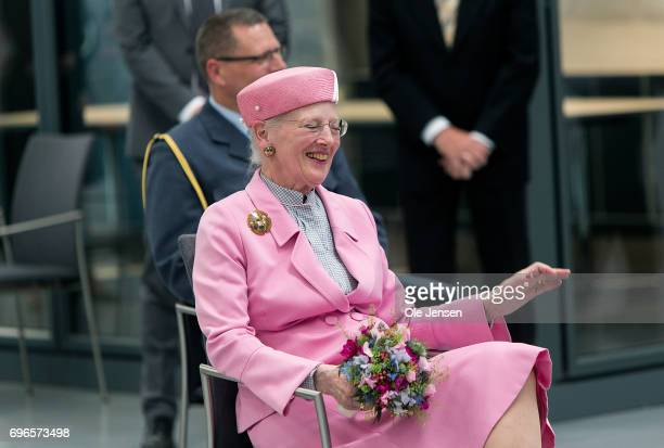Queen Margrethe of Denmark smiles during her visit at the company Riantics which presents a newly developed layr picker for the Queen during her...