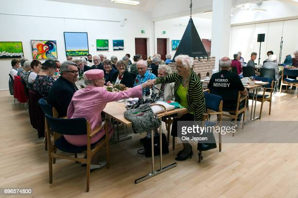 Queen Margrethe of Denmark visits an activity center for senior citizens during her visit on June 15 2017 in Hobro Denmark Queen Margrethe was on a...