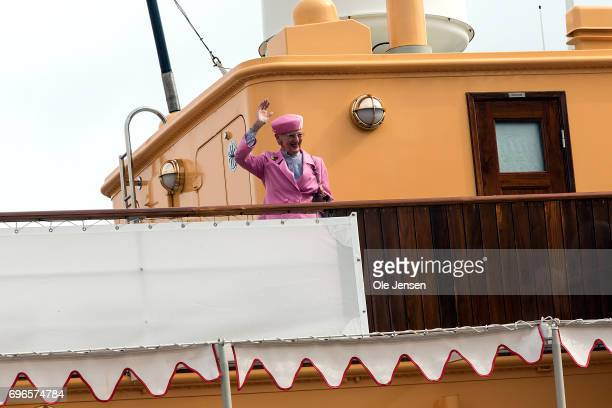 Queen Margrethe of Denmark waves to spectators during her arrival onboard the Royal ship Dannebrog on June 15 2017 in Hobro Denmark The Queen is on a...