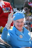 Queen Margrethe of Denmark waves to wellwishers from a carriage during celebrations marking her 70th birthday on April 16 2010 in Copenhagen Queen...